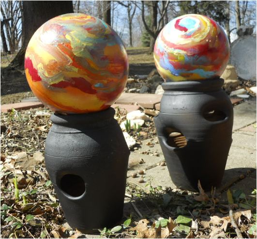 Recycled bowling balls going green turned into garden orbs